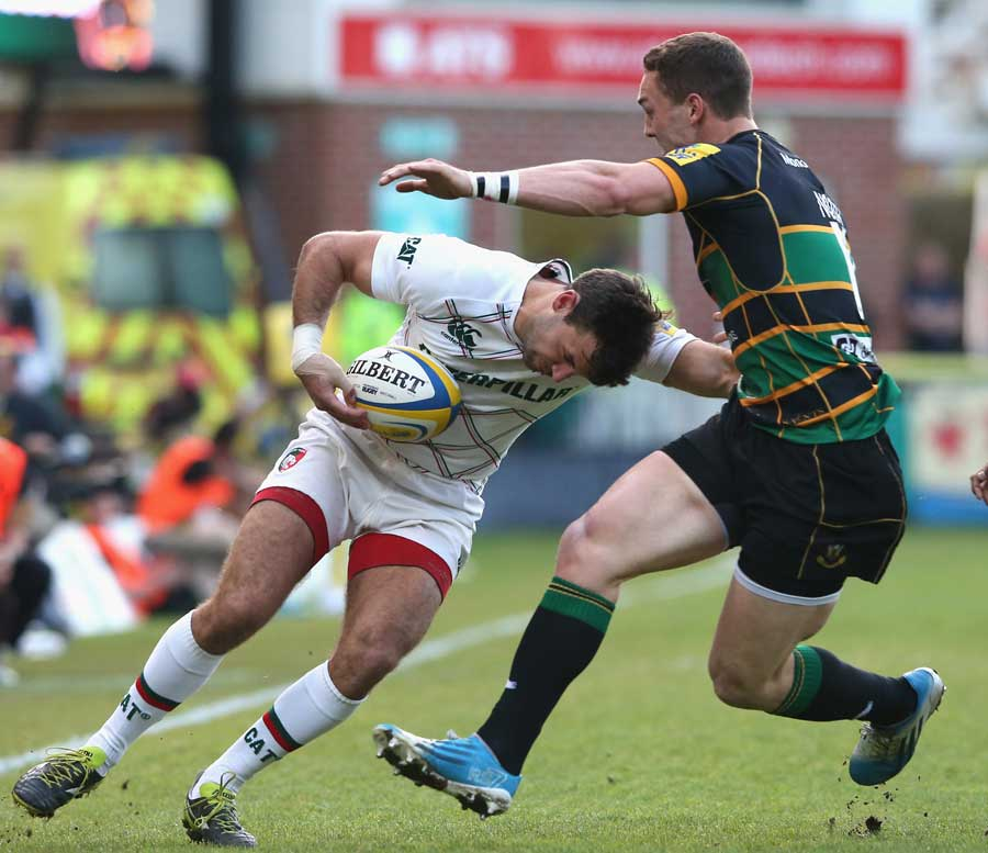 Leicester's Niall Morris tries to get past George North