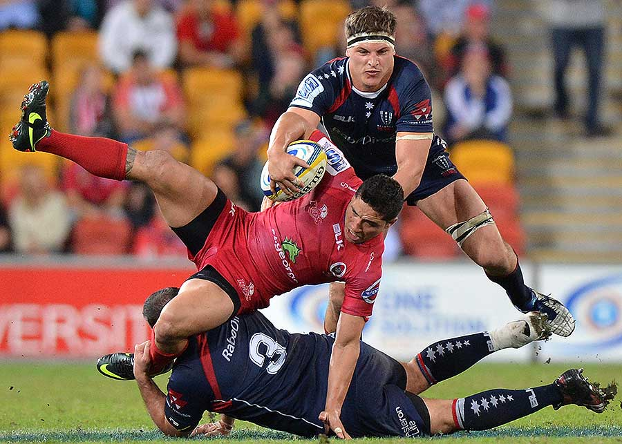 The Rebels' Laurie Weeks tackles the Reds' Anthony Fainga'a