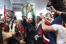 Toulon president Mourad Boudjellal holds the Heineken Cup aloft