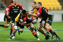 Chiefs' flanker Sam Cane is wrapped up in a tackle