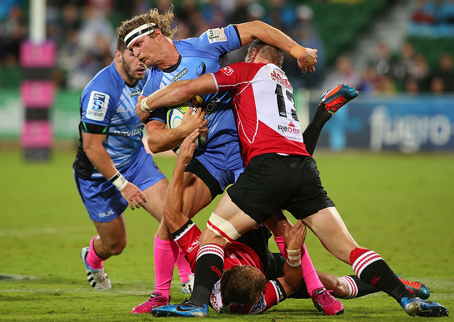 Western Force's winger Nick Cummins attempts to break through a tackle