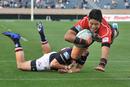 Japan's Yoshikazu Fujita flies over for a try