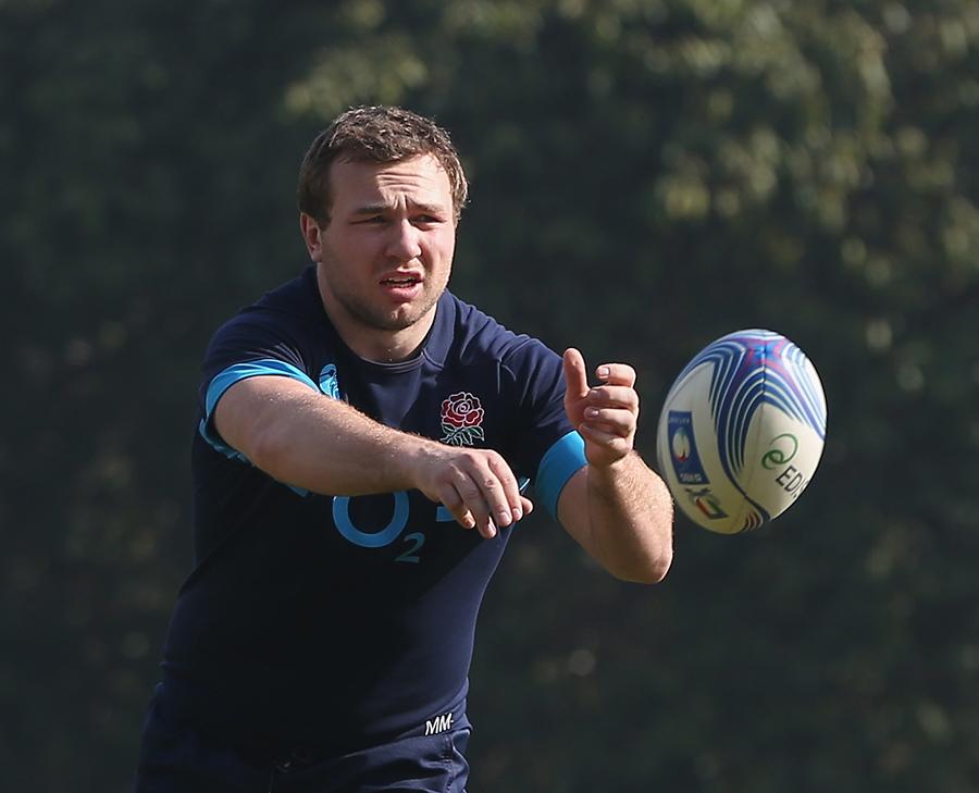 Matt Mullan passes the ball during England training