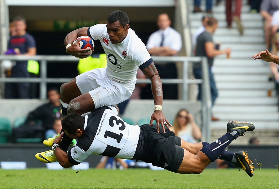 The Barbarians' Rene Ranger launches himself into a tackle against England's Semesa Rokoduguni