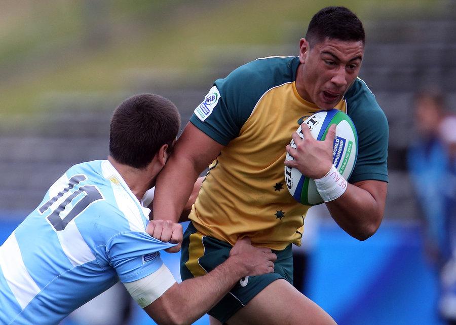 Lalakai Foketi of Australia is tackled by Patricio Fernandez of Argentina