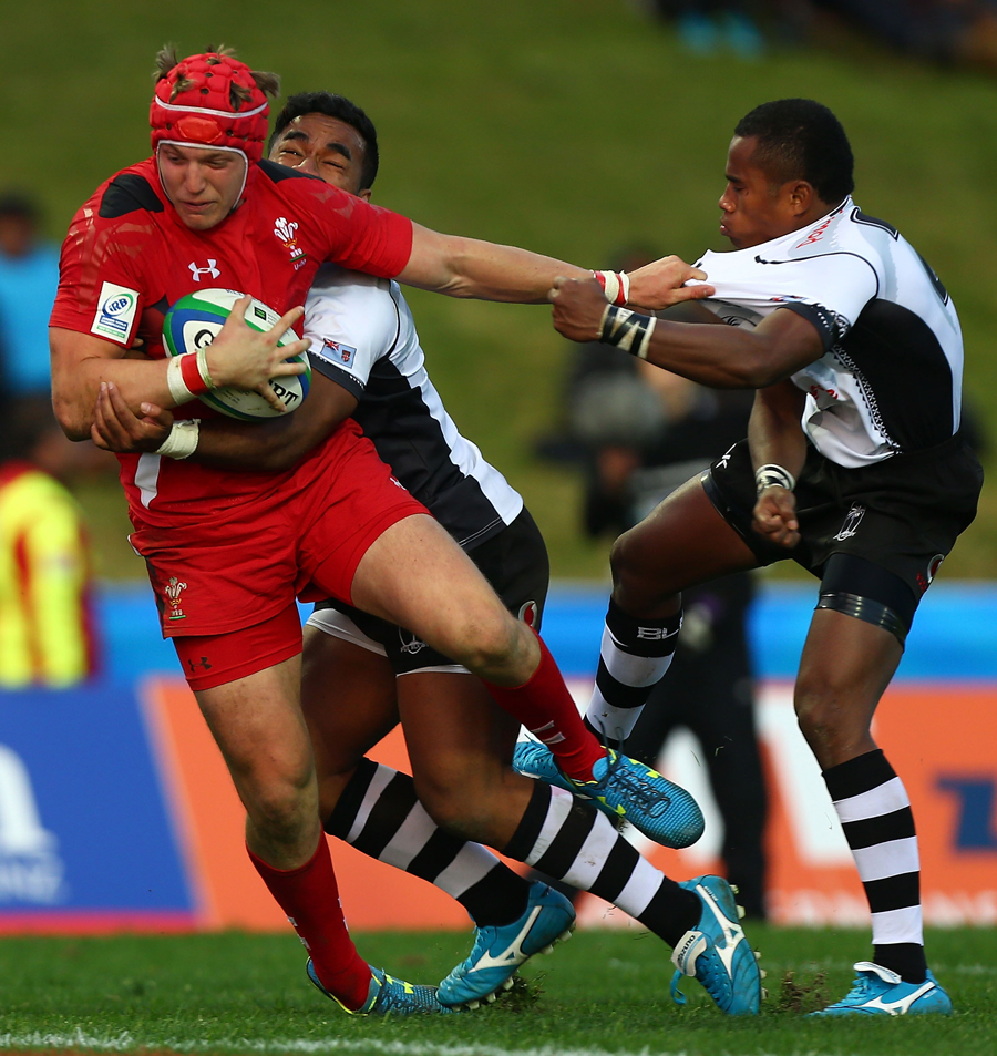 Tyler Morgan of Wales is tackled