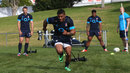 Kyle Eastmond pulls a weights sled during the England training session