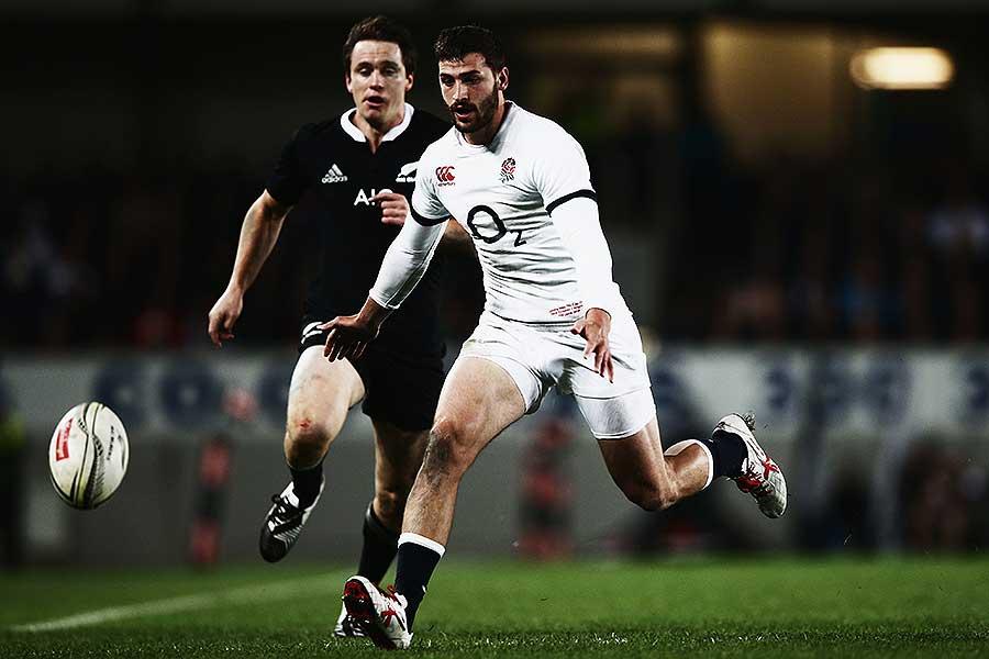 England's Jonny May beats New Zealand's Ben Smith to the ball