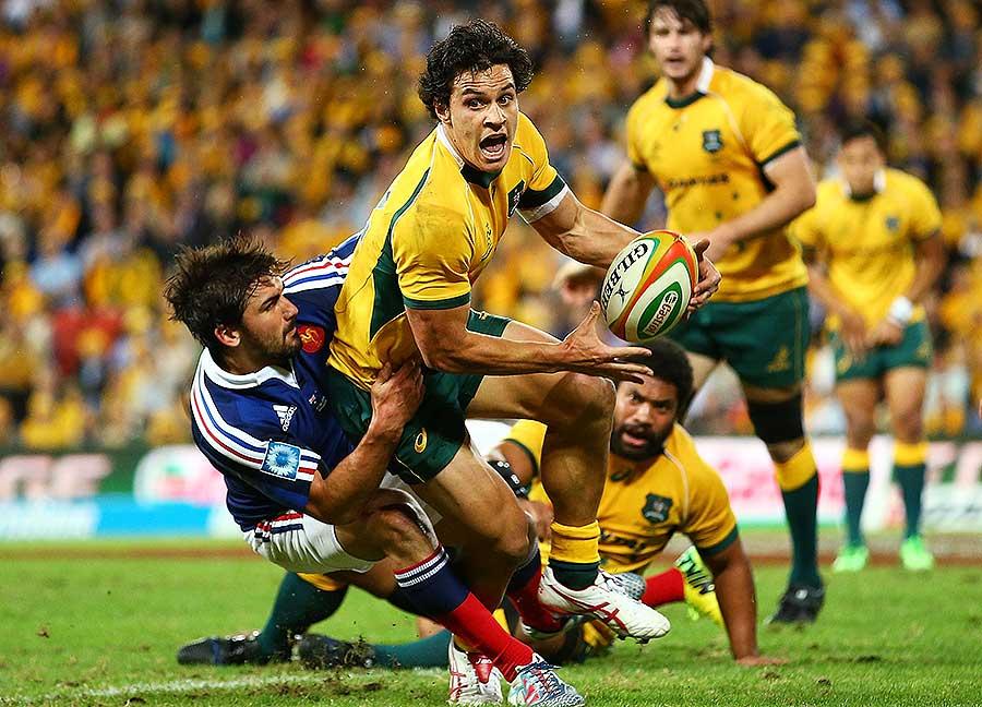 Australia's Matt Toomua looks to offoad
