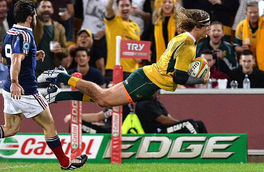 Australia's Nick Cummins dives over to score a try