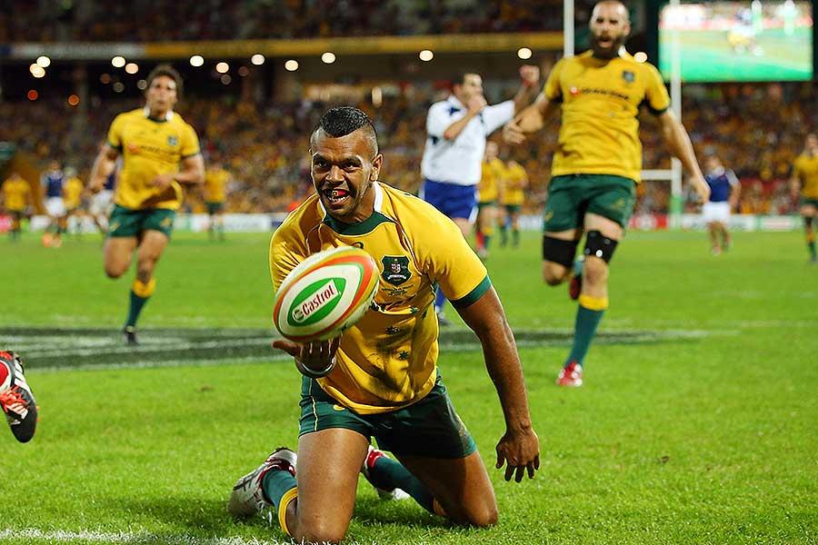 Australia's Kurtley Beale celebrates scoring a try