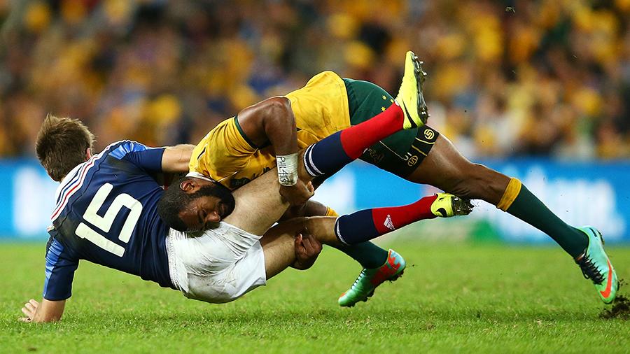 Australia's Tevita Kuridrani smashes France's Hugo Bonneval