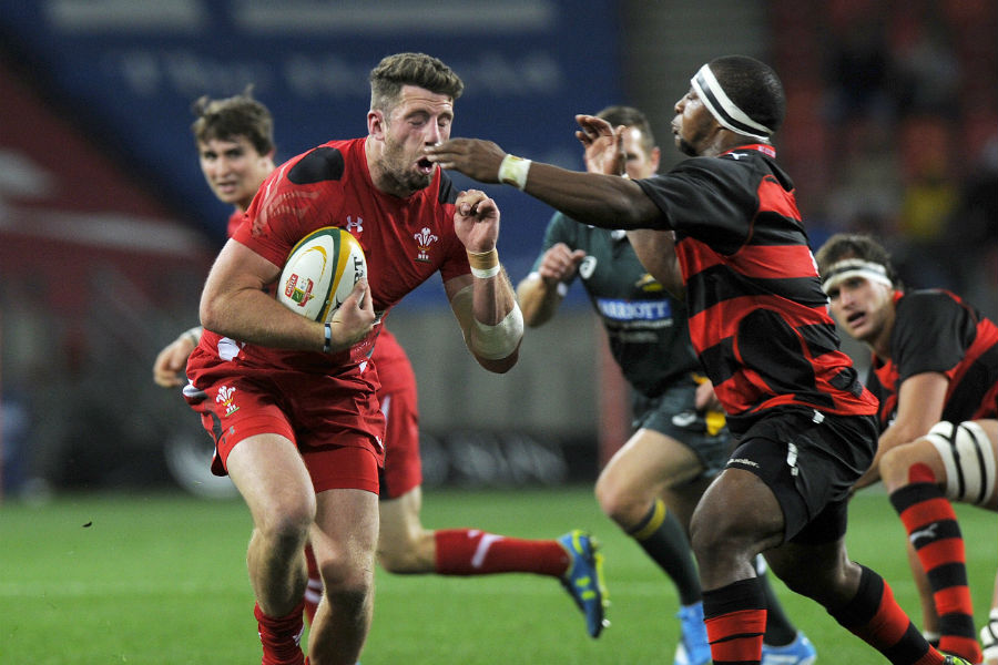 Alex Cuthbert is tackled by  Edgar Marutlulle