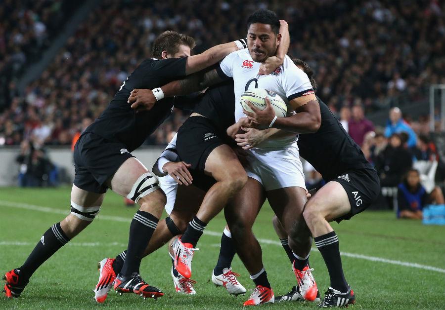England's Manu Tuilagi carries forward