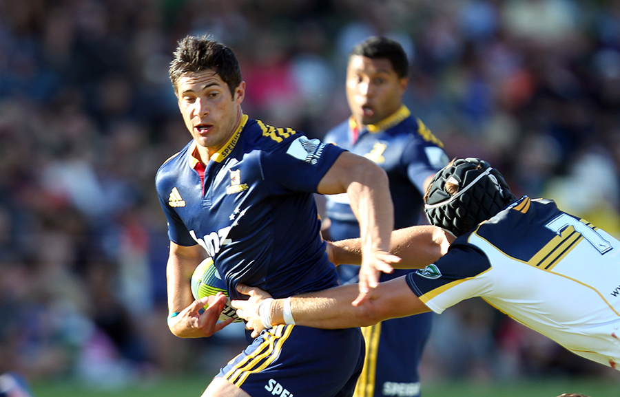 Phil Burleigh attempts to burst through a tackle
