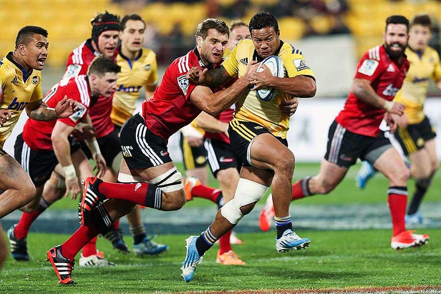 The Hurricanes' Alapati Leiua beats the tackle of Luke Whitelock
