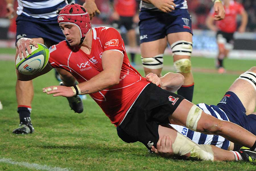 Warren Whiteley of the Lions dives over for a try