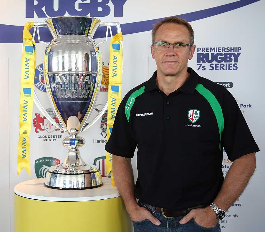 London Irish's Brian Smith alongside the Premiership trophy