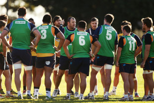 Waratahs coach Michael Cheika talks to players at training, Super Rugby, July 8, 2014