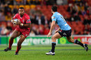 Queensland Reds' Samu Kerevi takes on Jono Lance