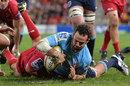 New South Wales Waratahs' Jono Lance scores a try