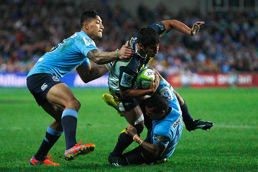 The Waratahs' Israel Folau and Alofa Alofa  tackle the Brumbies' Jarrad Butler