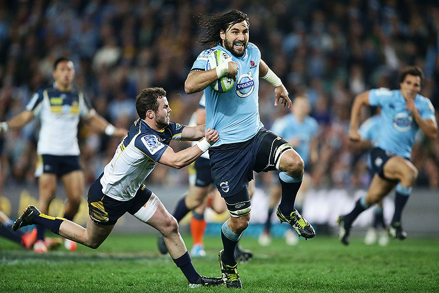 The Waratahs' Jacques Potgieter tears through the Brumbies' defence