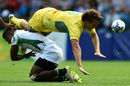 Con Foley is tackled by Sri Lanka's Richard Dharmapala