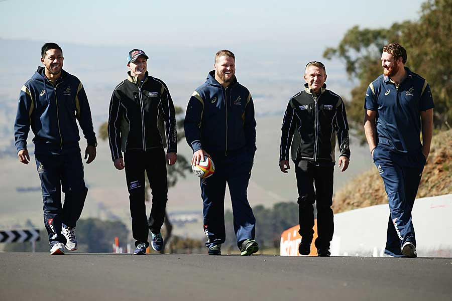 Australia's Christian Leali'ifano, James Slipper and Scott Higginbotham walk Mount Panorama with V8 Supercars drivers Mark Winterbottom, and Russell Ingall
