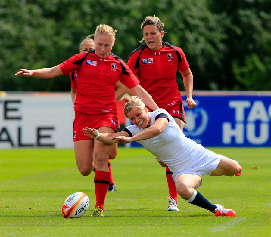 England's Danielle Waterman gets to the ball ahead of Canada's Mandy Marchak
