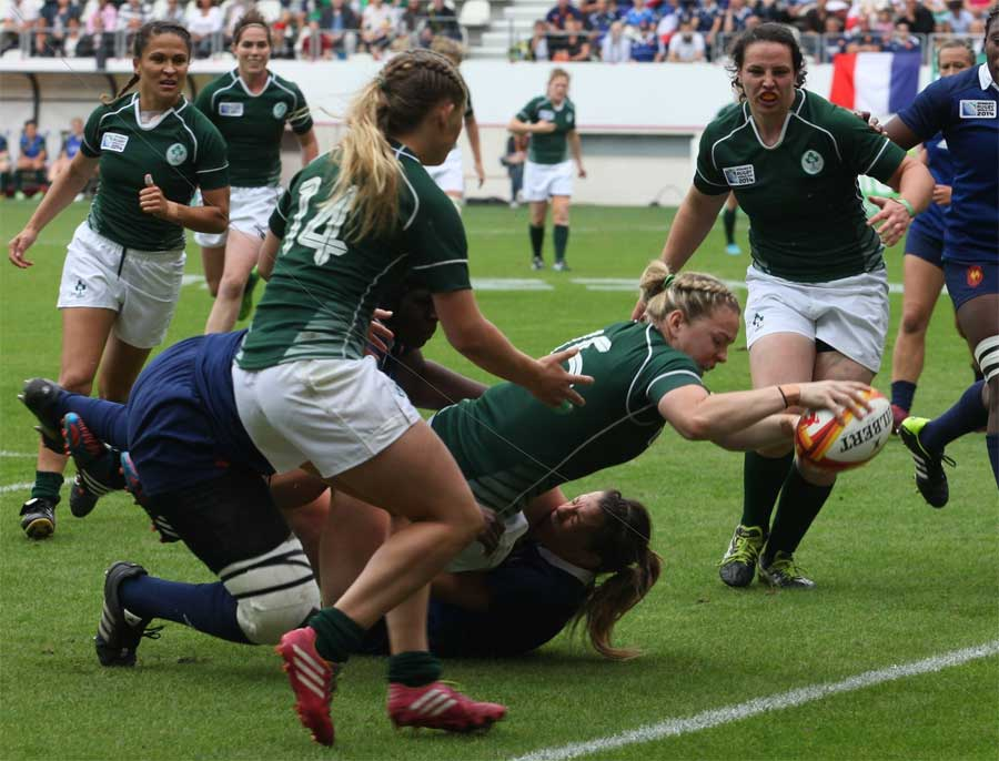 Ireland's Niamh Briggs stretches over to dot the ball down