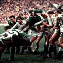 Willie John McBride ends up on top of the pack as England's Nigel Starmer-Smith tries to sneak away with the ball