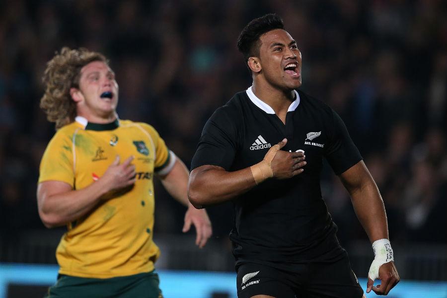 New Zealand's Julian Savea celebrates his try as Michael Hooper fails to catch him
