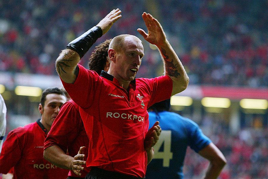 Wales' Gareth Thomas celebrates after breaking Ieuan Evans' Wales try-scoring record
