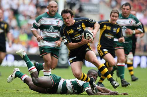 Fraser Waters of Wasps skips through a tackle