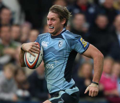 Cardiff Blues centre Jamie Robinson runs with the ball