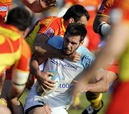 Thibauld Lacroix is tackled
