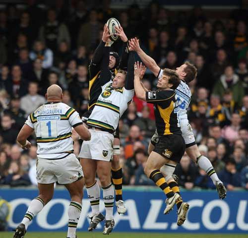 Rihard Birkett of Wasps claims a high-ball under pressure