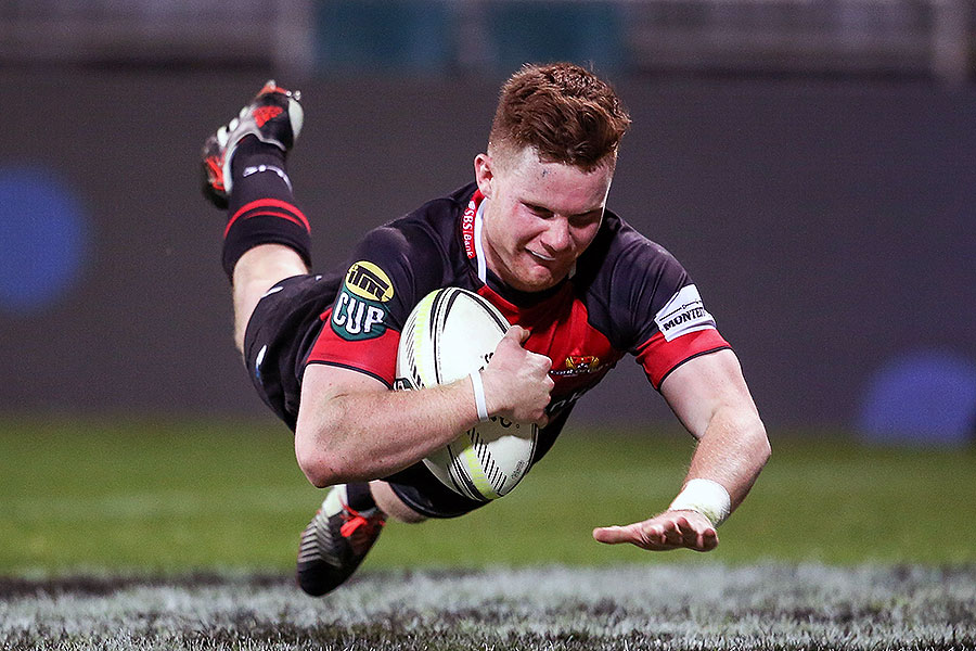 Canterbury's Mitchell Drummond dives to score a try