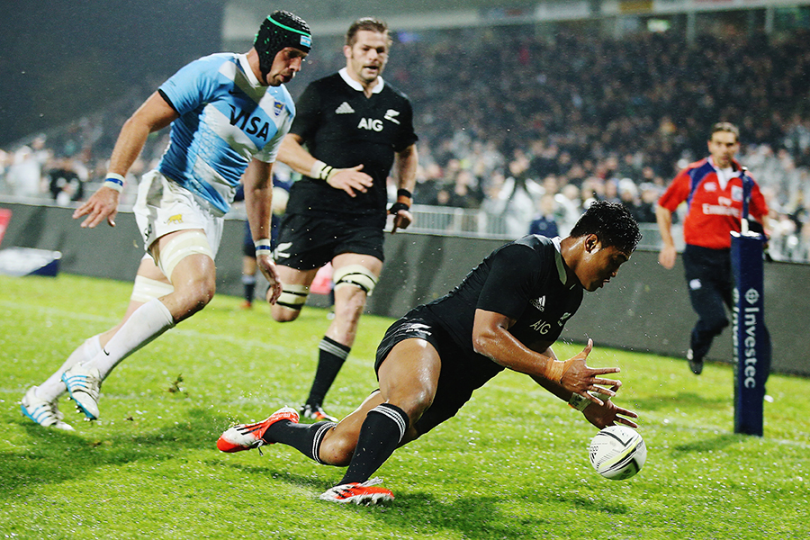 All Blacks' wing Julian Savea dives on the ball to score a try
