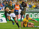 Springboks' winger Cornal Hendricks brushes past a Wallabies defender to score a try