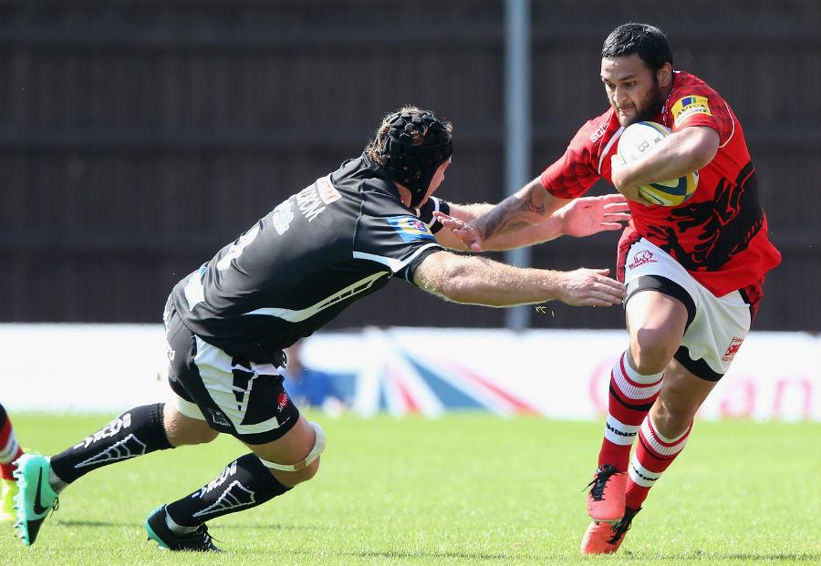 London Welsh's Piri Weepu attempts to dodge past Thomas Waldrom