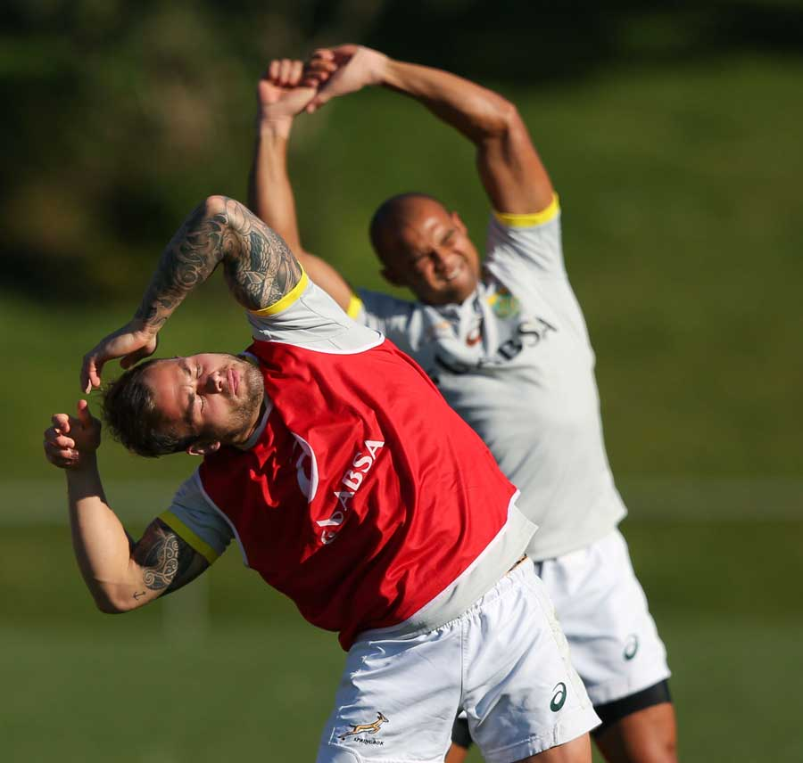 South Africa's Francois Hougaard and Cornal Hendricks stretch in training