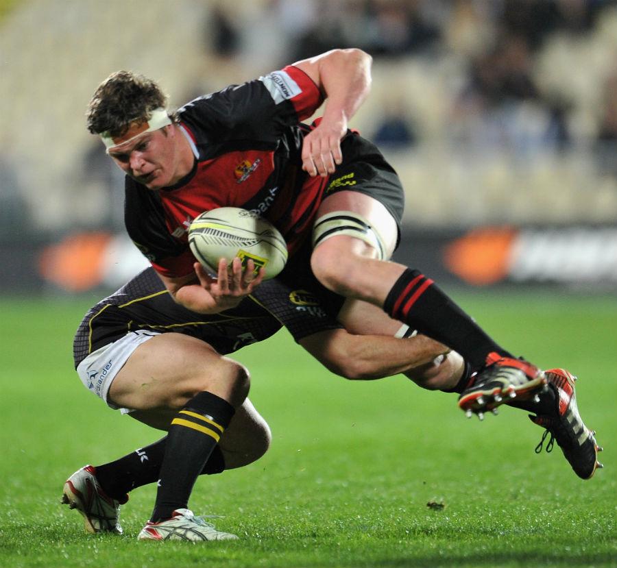 Scott Barrett of Canterbury is tackled by Shaun Treeby of Wellington