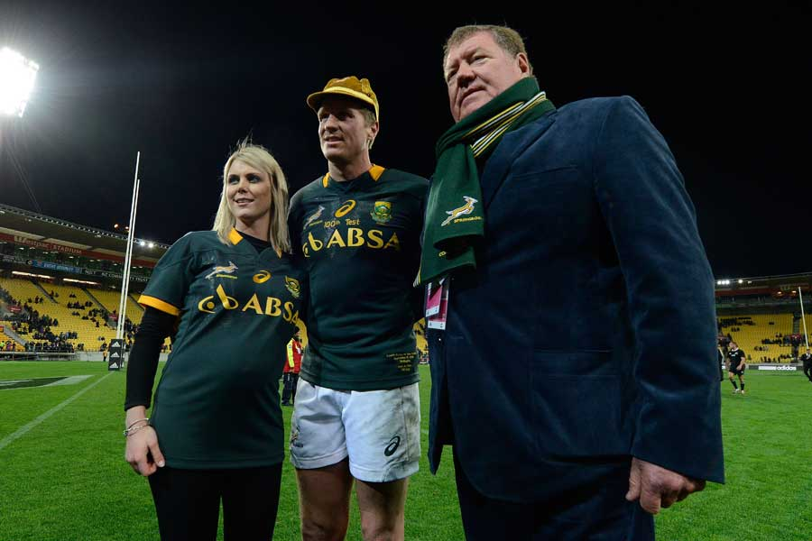 South Africa's Jean de Villiers stands alongside his wife and father on his 100th appearance