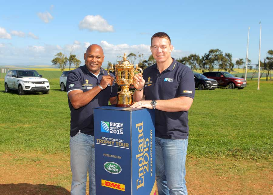 South Africa's Chester Williams and John Smit pose next to the World Cup