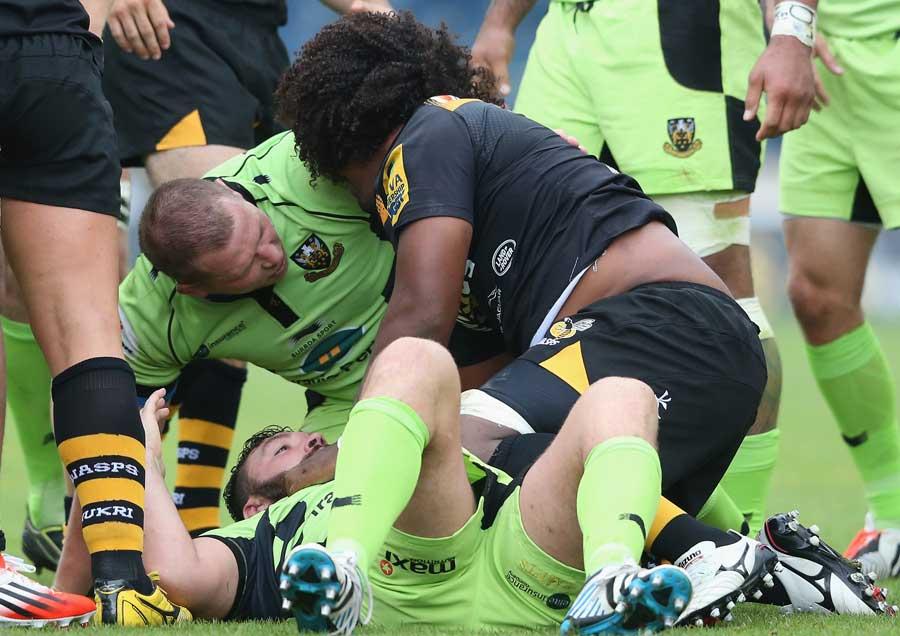 Northampton Saints' Alex Corbisiero has a scrap with Ashley Johnson