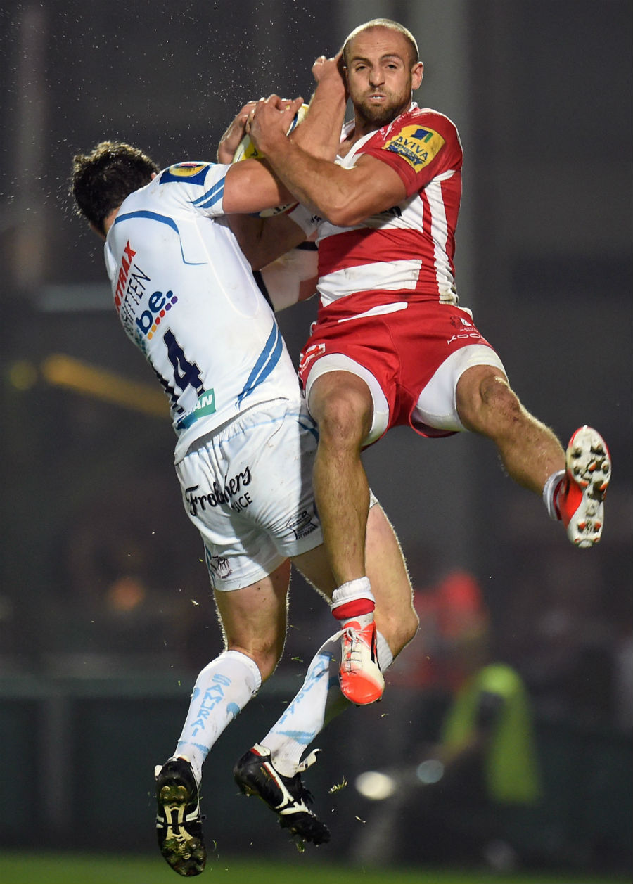 Ian Whitten and Charlie Sharples clash for the ball
