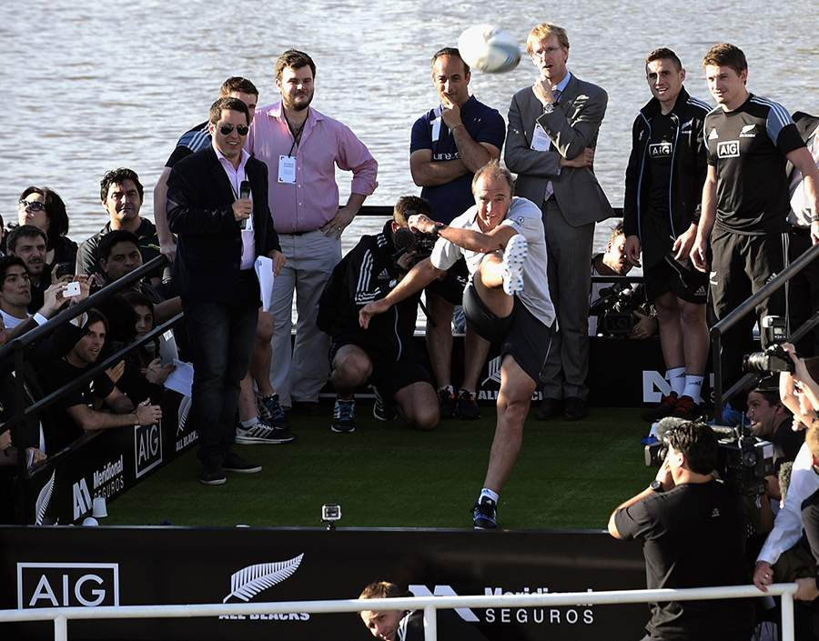 Former Los Pumas captain Hugo Porta kicks a ball over the Woman' Bridge during a kicking contest held on board the Galileo catamaran