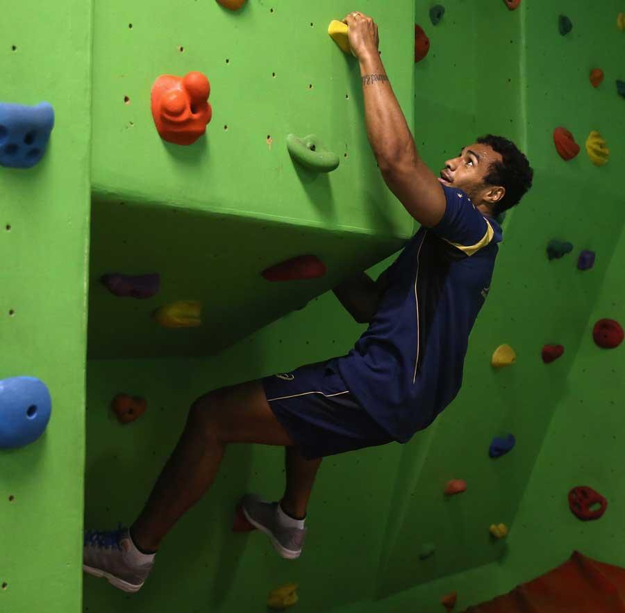 Wallabies scrum-half Will Genia tries out a spot of rock climbing